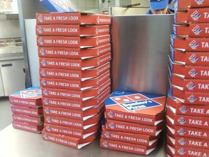 lots of pizza menus and boxes
